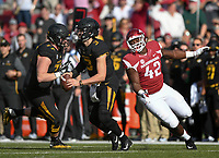 NWA Democrat-Gazette/CHARLIE KAIJO Arkansas Razorbacks defensive lineman Jonathan Marshall (42) rushes Missouri Tigers quarterback Drew Lock (3) in the first half during a football game on Friday, November 24, 2017 at Razorback Stadium in Fayetteville.