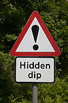 Red triangle road sign for Hidden Dip