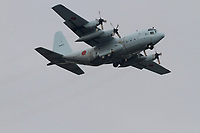 A Lockheed C130 Hercules transport aircraft with the Japanese Air Self Defence Force (JSDF) flying over Chou Rinkan, Kanagawa, Japan, Tuesday December 13th 2016