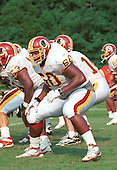 Washington Redskins offensive tackle Chris Samuels (60), the second of two of the team's first round draft pick in the 2000 NFL Draft (third overall pick in the draft), and who played his college football at the University of Alabama, participates in blocking drills during Redskin training camp at Redskin Park in Ashburn, Virginia on July 21, 2000.<br /> Credit: Arnie Sachs / CNP