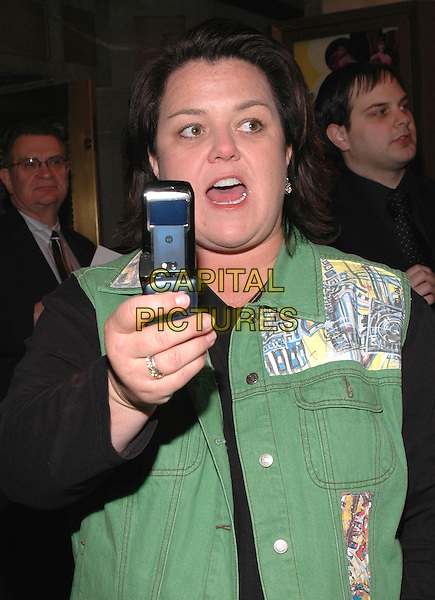 "ROSIE O'DONNELL.The premiere of the musical ""Sweet Charity"" on Broadway. .May 4th, 2005.Photo Credit: Patti Ouderkirk/AdMedia.half length camera phone mobile green vest mouth open.www.capitalpictures.com.sales@capitalpictures.com.© Capital Pictures."