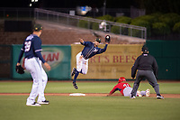 Northwest Arkansas Naturals infielder Gabriel Cancel (18) leaps to make a catch as Springfield Cardinals outfielder Johan Mieses (41) safely steals second on May 18, 2019, at Arvest Ballpark in Springdale, Arkansas. (Jason Ivester/Four Seam Images)