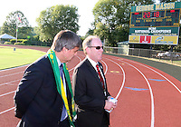 Harold Mayne-Nicholl with D.C. United president Kevin Payne leaves the pitch at George Mason soccer field during the visit of the FIFA World Cup 2018-2022 inspection delegation to George Mason University soccer practice facility.