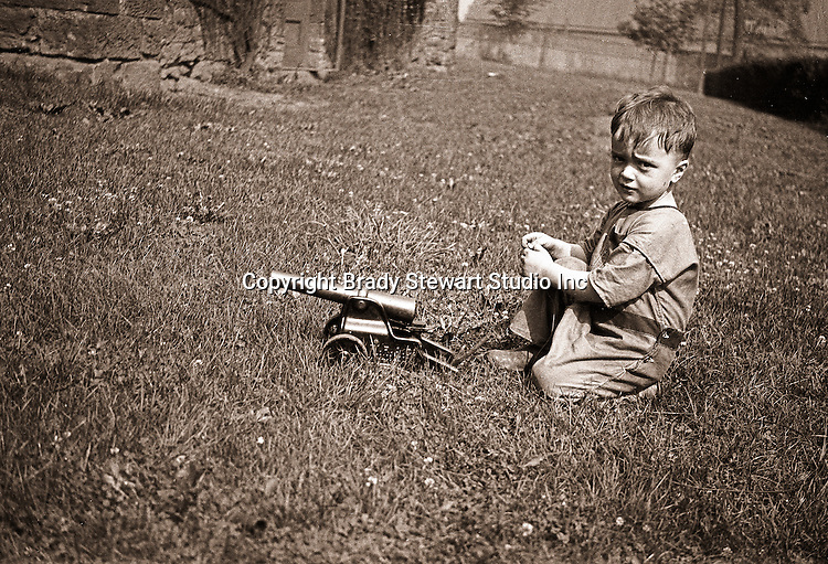 Wilkinsburg PA: Brady Stewart Jr. playing with a toy canon - 1923