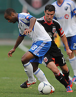 Montreal Impact midfielder Collen Warner (18) goes against D.C. United forward Chris Pontius (13) D.C. United defeated Montreal Impact 3-0 at RFK Stadium, Saturday June 30, 2012.