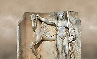 "Close up of a Roman Sebasteion relief  sculpture of  Bellerophon Aphrodisias Museum, Aphrodisias, Turkey. Against an art background.<br /> <br /> Bellerophon was a Lykian hero and was claimed as a founder of Aphrodisias. He holds his winged horse Pegasos. The deign was modelled on another relief panel in the series ""Royal hero with Dod Hunting"". The carving is poor and the sculptor may have been a novice.modelled"