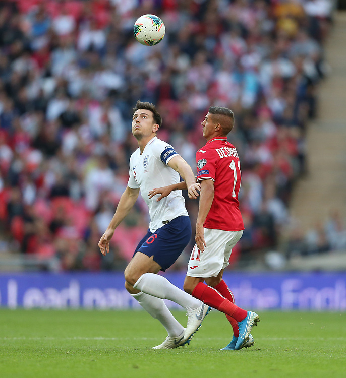 England's Harry Maguire and Bulgaria's Kiril Despodov<br /> <br /> Photographer Rob Newell/CameraSport<br /> <br /> UEFA European Championship Qualifying Group A - England v Bulgaria - Saturday 7th September 2019 - Wembley Stadium - London<br /> <br /> World Copyright © 2019 CameraSport. All rights reserved. 43 Linden Ave. Countesthorpe. Leicester. England. LE8 5PG - Tel: +44 (0) 116 277 4147 - admin@camerasport.com - www.camerasport.com