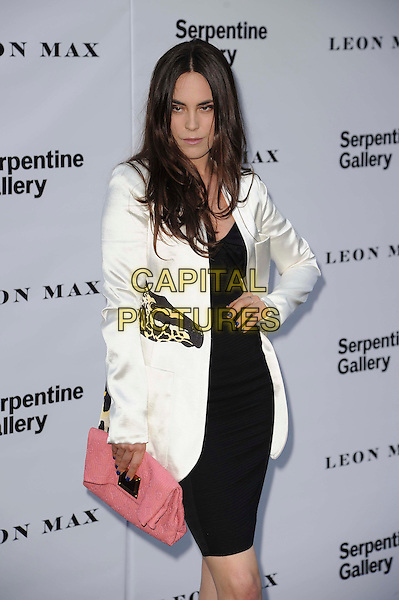 Guest.Serpentine Galley Summer Party, Kensington Palace Gardens, London, England..26th June 2012.half length black dress white blazer pink clutch bag hand on hip.CAP/CAS.©Bob Cass/Capital Pictures.