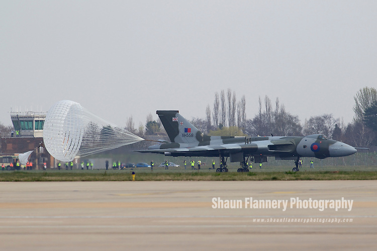 Pix: Shaun Flannery/shaunflanneryphotography.com...COPYRIGHT PICTURE>>SHAUN FLANNERY>01302-570814>>07778315553>>..29th March 2011..............The last flying Vulcan, XH558,  touches down at Robin Hood Airport Doncaster Sheffield. .Vulcan XH558 is to spend the summer based at the airfield where she once stood on Quick Reaction Alert during the Cold War..Parachute deploy..