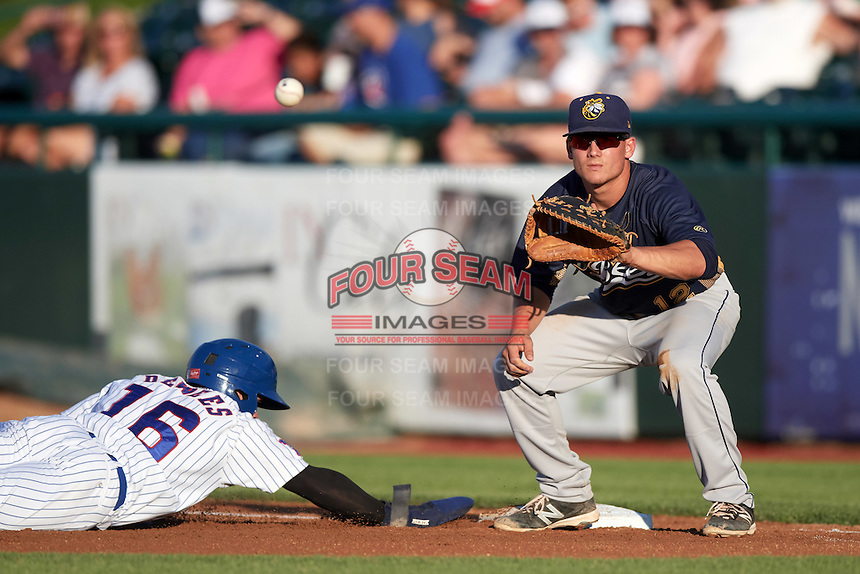 Burlington Bees first baseman Matt Thaiss (12) waits for a throw as Donnie Dewees (16) dives back to the bag during a game against the South Bend Cubs on July 22, 2016 at Four Winds Field in South Bend, Indiana.  South Bend defeated Burlington 4-3.  (Mike Janes/Four Seam Images)