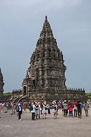 Yogyakarta, Java, Indonesia.  Visitors at the Prambanan Temples.  Nandi Temple in Background.