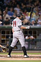Joey Terdoslavich (39) of the Indianapolis Indians spits as he stands in to bat during the game against the Charlotte Knights at BB&T BallPark on June 16, 2017 in Charlotte, North Carolina.  The Knights defeated the Indians 12-4.  (Brian Westerholt/Four Seam Images)