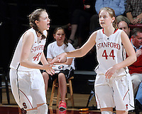 STANFORD, CA - February 27, 2014: Stanford Cardinal's Bonnie Samuelson congratulates sister Karlie Samuelson during Stanford's 83-60 victory over Washington at Maples Pavilion.