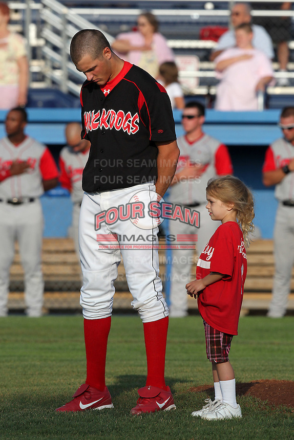 "Batavia Muckdogs pitcher Kevin Siegrist with a ""fan of the game"" before a game vs. the Lowell Spinners at Dwyer Stadium in Batavia, New York July 14, 2010.   Batavia defeated Lowell 12-2.  Photo By Mike Janes/Four Seam Images"