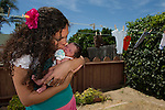 A mother poses with her six-week old son for a portrait in their backyard in Ventura, Calif., on July 10, 2012