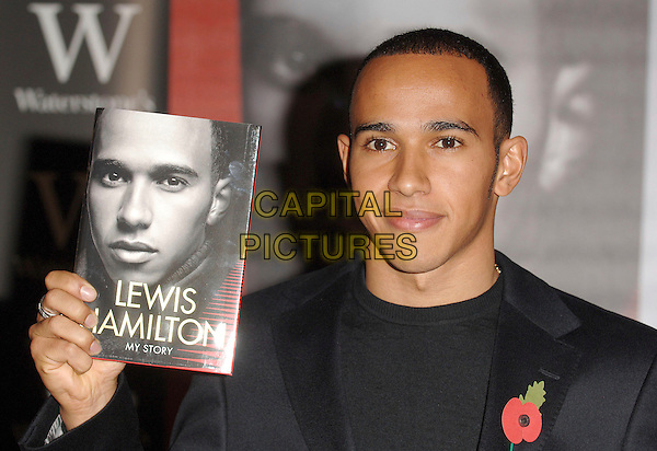 LEWIS HAMILTON.The Formula 1 driver signs copies of his autobiography, My Story, following his recent disappointment at the Brazilian Grand Prix. Waterstone's, Piccadilly, London, England..November 5th, 2007.headshot portrait autobiography booksigning poppy black suit jacket .CAP/ BEL.©Tom Belcher/Capital Pictures.