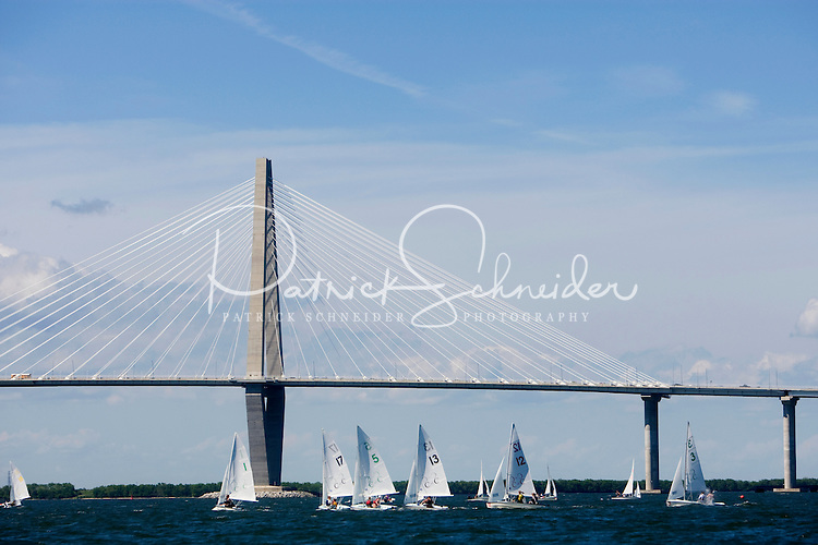 Tourists sail along the Cooper River with the backdrop of the Cooper River Bridge in Charleston, SC.