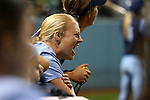 CHAPEL HILL, NC - FEBRUARY 24: UNC players on the bench cheer on their teammates in the ninth inning. The University of North Carolina Tar Heels played the Towson University Tigers on February, 24, 2017, at Anderson Softball Stadium in Chapel Hill, NC in a Division I College Softball match. UNC won the game 6-5 in nine innings.