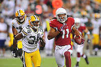 Aug. 28, 2009; Glendale, AZ, USA; Arizona Cardinals wide receiver (11) Larry Fitzgerald is pursued by Green Bay Packers cornerback (38) Tramon Williams during a preseason game at University of Phoenix Stadium. Mandatory Credit: Mark J. Rebilas-