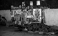 12.2010 Varanasi (Uttar Pradesh)<br /> <br /> Monkey with man sleeping in the street with god and goddess images behind him.<br /> <br /> Un homme et un singe dormant dans la rue avec des images de dieux et d&eacute;esses d&egrave;rri&egrave;re lui.