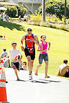A triathlete is joined by his two children as he races to the finishline at the annual ChelanMan Multisport Weekend held in Chelan every July.