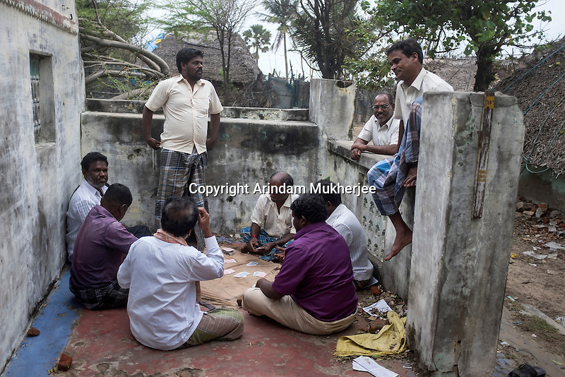 Fishermen playing card at a Tsunami (2004) destroyed house at Akerapett in Nagapattinam, Tamil Nadu, India.
