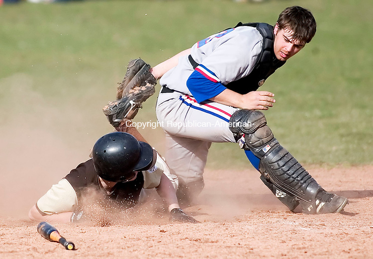 WOODBURY, CT- 11 APRIL 07- 041107JT04- <br /> Thomaston's Chris Laliberte scores the third run after sliding past Nonnewaug catcher Greg Carlson after a sacrifice fly by Dave Green at Wednesday's game at Nonnewaug. Thomaston won 4-2.<br /> Josalee Thrift Republican-American