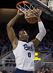 Nevada forward  Tre'Shawn Thurman (0) dunks the ball against Utah State in the first half of an NCAA college basketball game in Reno, Nev., Wednesday, Jan. 2, 2019. (AP Photo/Tom R. Smedes)