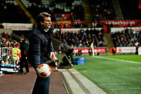 Thursday 28 November  2013  Pictured:Michael Laudrup, Manager of Swansea City throws the ball back into play<br /> Re:UEFA Europa League, Swansea City FC vs Valencia CF  at the Liberty Staduim Swansea