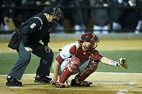 Florida State Seminoles catcher Cal Raleigh (35) frames a pitch as home plate umpire Frank Sylvester looks on during the game against the Wake Forest Demon Deacons at David F. Couch Ballpark on March 9, 2018 in  Winston-Salem, North Carolina.  The Seminoles defeated the Demon Deacons 7-3.  (Brian Westerholt/Four Seam Images)