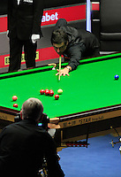 Ronnie O'Sullivan pots a red ball during the Dafabet Masters FINAL between Barry Hawkins and Ronnie O'Sullivan at Alexandra Palace, London, England on 17 January 2016. Photo by Liam Smith / PRiME Media Images