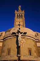 Christ on the cross outside the Nortre Dame De La Garde at sunset, Marseille, France.