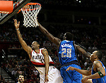 04/03/11--Blazers center Marcus Camby sneaks by Mavericks' Ian Mahinmi for a lay-up in the first half at the Rose Garden in Portland, Or.. Portland defeated Dallas 104-96.Photo by Jaime Valdez........................................