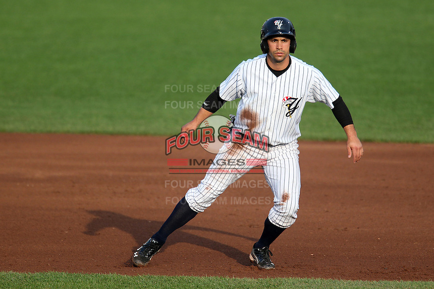 Empire State Yankees second baseman Kevin Russo #7 leads off first during the first game of a double header against the Columbus Clippers at Frontier Field on May 8, 2012 in Rochester, New York.  Columbus defeated Empire State 1-0.  (Mike Janes/Four Seam Images)