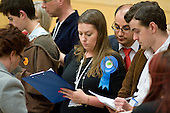 Party observers take notes during the count for the Hampstead and Kilburn constituency in the General Election 2010.