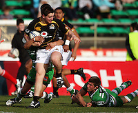 Wellington hooker Dane Coles is tackled by Aaron Smith during the Air NZ Cup preseason match between Manawatu Turbos and Wellington Lions at FMG Stadium, Palmerston North, New Zealand on Friday, 17 July 2009. Photo: Dave Lintott / lintottphoto.co.nz