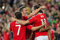 Gareth Bale of Wales celebrates scoring his side's third goal with Andy King and Joe Allen during the FIFA World Cup Qualifier match between Wales and Moldova at Cardiff City Stadium, Cardiff, Wales on 5 September 2016. Photo by Mark  Hawkins.
