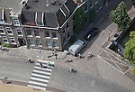 Looking down from overhead to cobbled street with cyclists, Dordrecht, Netherlands