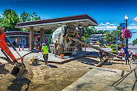 Concrete workers lay a new roadway into the sun coo station at Walnut and State St. in Uptown Westerville.