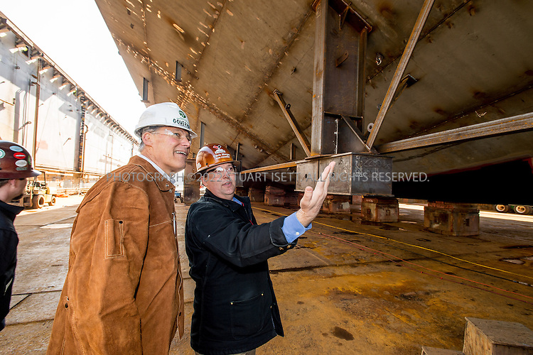 3/8/2013--Seattle, WA, USA<br /> <br /> Washington State Governor Jay Inslee with Vigor VP Chris Morgan tours the construction of the Tokitae ferry expected for delivery to Washington States ferries in 2014 and under construction at Vigor Industrial Seattle shipyard. <br /> <br /> Washington State Ferries and Vigor Industrial commemorated the state&rsquo;s newest 144-car ferry, the Samish, with a keel laying ceremony at Vigor&rsquo;s Seattle shipyard on March 8. Washington State Governor Jay Inslee officially kicked off construction by making the first weld on the keel of the new ferry. The keel laying and first weld are maritime traditions equivalent to placing the cornerstone in a new building.<br /> <br /> Photograph by Stuart Isett/Vigor