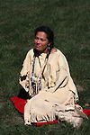 A Native American Indian woman sitting on a blanket