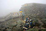 Group of hikers at the Tip Top House museum on the summit of Mount Washington, New Hampshire, USA