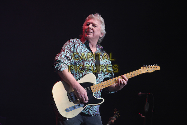 BAD COMPANY - Mick Ralphs.Performing live at Wembley Arena, London, England..April 11th, 2010.stage concert live gig performance music half length white brown shirt blue pattern guitar .CAP/MAR.© Martin Harris/Capital Pictures.