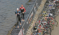 11 AUG 2007 - NOTTINGHAM, UK - Competitors run to tag their teammates after the second leg of the afternoons swim - British Club Relay Triathlon Championships. (PHOTO (C) NIGEL FARROW)