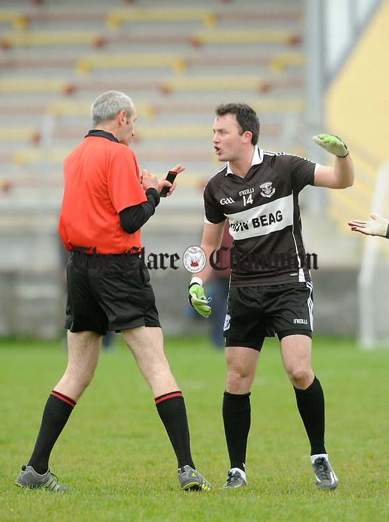 David Tubridy of Doonbeg makes a point to referee Gerry Keane after one of his free kicks was deemed wide against Miltown during their Cusack Cup game at Miltown. Photograph by John Kelly.