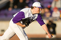 Patrick Somers #26 of the East Carolina Pirates follows through on his delivery at Clark-LeClair Stadium on February 19, 2010 in Greenville, North Carolina.   Photo by Brian Westerholt / Four Seam Images