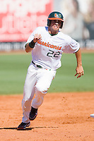 Chris Pelaez #22 of the Miami Hurricanes rounds second base against the Florida State Seminoles at the 2010 ACC Baseball Tournament at NewBridge Bank Park May 26, 2010, in Greensboro, North Carolina.  The Hurricanes defeated the Seminoles 9-3.  Photo by Brian Westerholt / Four Seam Images