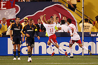 New York Red Bulls midfielder (13) Clint Mathis celebrates scoring with forward (9) Juan Pablo Angel as Los Angeles Galaxy midfielder (7) Chris Klein and midfielder (23) David Beckham walk back to midfield during an MLS regular season match at Giants Stadium, East Rutherford, NJ, on August 18, 2007. The Red Bulls defeated the Galaxy 5-4.