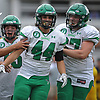 Neil Levantini #44 of Farmingdale gets congratulated by teammates after recording a sack in the fourth quarter of a Nassau County Conference I varsity football game against host Massapequa High School on Saturday, Sept. 22, 2018. Farmingdale won by a score of 41-27.