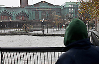 A man take a look at Hoboken train station as Hurricane Sandy begins to affect the area in Jersey City, United States. 29/10/2012. Photo by Kena Betancur/VIEWpress.